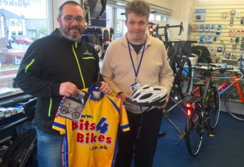 Matthew receiving his new bike helmet courtesy of Bits 4 Bikes.